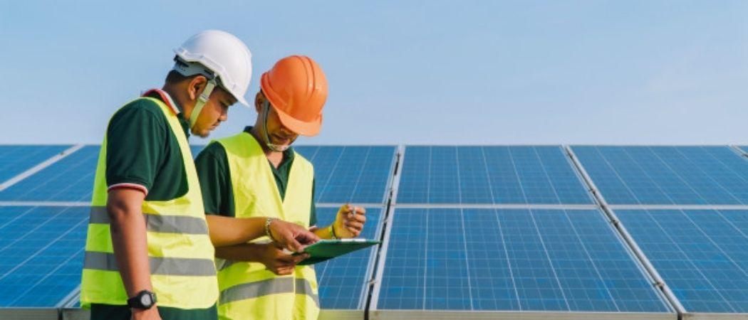 engineers inspect solar panel